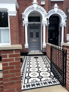 Victorian mosaic tile path with black and white tiles, red brick wall, Yorkstone coping and bull nose York stone step and entrance stone London