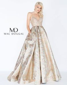 Envied in gold! Exquisite v-neck prom gown embellished with multi-colored beaded bodice and straps. The ornately beaded bodice gives way to a full metallic brocade skirt with pockets!