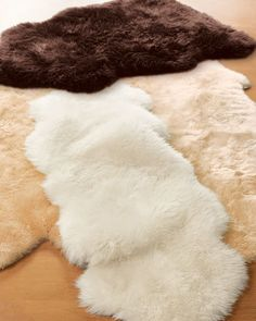 Faux sheepskin rugs...perfect for a bedroom.
