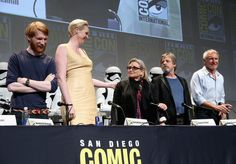 """Carrie Fisher Photos Photos - (L-R) Actors Domhnall Gleeson, Gwendoline Christie, Carrie Fisher, Mark Hamill and Harrison Ford at the Hall H Panel for """"Star Wars: The Force Awakens"""" during Comic-Con International 2015 at the San Diego Convention Center on July 10, 2015 in San Diego, California. - Star Wars: The Force Awakens Panel at San Diego Comic Con - Comic-Con International 2015"""