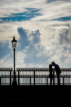 How romantic is a sweet kiss on a bridge at Epcot's World Showcase. Photo: Jacob, Disney Fine Art Photography