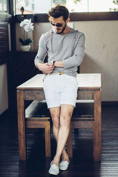 For an everyday outfit that is full of character and personality pair a grey hoodie with white shorts. Polish off the ensemble with white canvas espadrilles.   Shop this look on Lookastic: https://lookastic.com/men/looks/hoodie-shorts-espadrilles/20258   — Black Sunglasses  — Grey Hoodie  — Black Leather Watch  — Beige Woven Canvas Belt  — White Shorts  — White Canvas Espadrilles  — No Show Socks