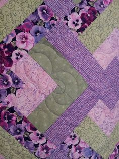 a little closer of the stitches on Rosalie's Pansy quilt