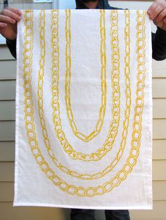 """Rev up the glamour in your kitchen with these """"Gold Chain"""" tea towels by #SCAD alum Kay Wolfersperger, $16 ea. #savannah #art #shopscad"""