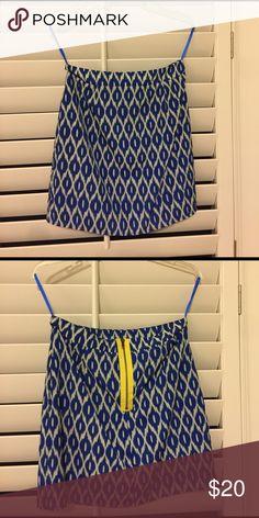Blue and off white geometric skirt Royal blue and off white geometric print, includes pockets, a fun yellow zipper in the back, and a liner underneath (attached to the skirt). 100% polyester. Looks great with an off white tank or blouse... dress it up with heels at night or flats during the day! Skirts Mini