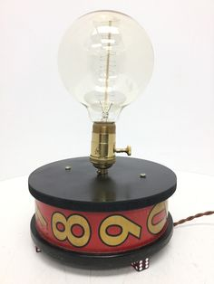 VINTAGE RED REEL LIGHT WITH EDISON LIGHT BULB & DICE FOR LEGS.  - Warner Bros. Property Department