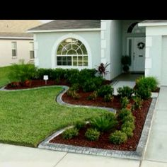 Landscaping idea - Edging and shrubs i like the different textures of the greenery
