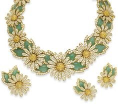 The Daisy Parure by Van Cleef & Arpels. Elizabeth Taylor borrowed this diamond, colored diamond, and chrysoprase, parure from Van Cleef and Arpels for a benefit and she liked wearing it so much that she bought it.