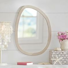 Swell Mirror // Add a sprinkle of surf to your room with this droplet-shaped mirror. Made from white-washed, FSC-certified wood, it's exclusively designed with 11-time world surfing champ Kelly Slater.