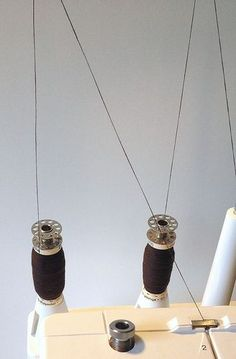 Instead of buying four cones of thread for the serger, make bobbin cones to save money.  Great idea.