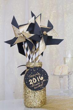 NYE: Twelve unique handmade pinwheels with glittery gold centers make the perfect party favor or decorative element in a shimmering gold container
