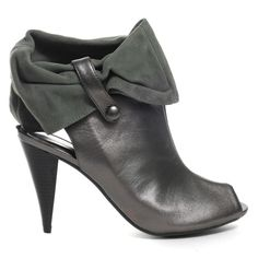 You will be one happy camper when you slide your feet in Cindy Says' Camp booties. Camp features a pewter leather upper with a trendy open-toe, slingback, inner ankle zip, grey suede slouchy ankle cuff that can be worn in different ways, and a 3 ½ inch cone stacked heel. Fashion-forward, fun, and versatile!