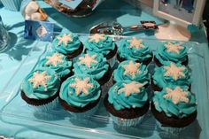 Snowflake cupcakes at a Frozen birthday party!  See more party planning ideas at CatchMyParty.com!