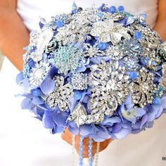 Hydrangea and broach bouquet... a little over the top though...
