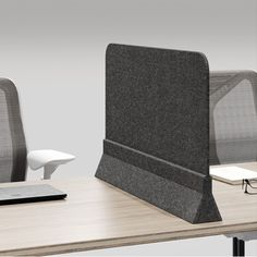 Acoustic Screens Felt  Solo is a clean and simple free standing desk divider screen. The soft corners and angular base fit the aesthetic of your office. There is no need for assembly, just unpack and set it in position. With a variety of height and depth options, Solo is an easy add-on to your existing desk or benching configuration. Up to 60% Pre-Consumer Recycled PET Felt #interiordesign #acoustics #walls #ecofriendly #screens Office Inspo, Office Desk, Desk Partitions, Acoustic Fabric, Desk Dividers, Green House Design, Divider Screen, Partition Design, Medical Design