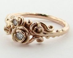 Oh my gosh, I loved this ring, until I followed the links and found an even more amazing white gold rose wedding band set. That is the one I adore, I need to figure out how to make my own pins....