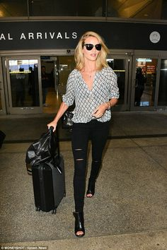 Rosie Huntington-Whiteley.. Paige Sammy Top, Paige Verdugo Arlo Destructed Jeans, Givenchy Tote, Gianvito Rossi Booties, and Tom Ford Fany Shades..