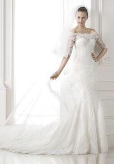 Pronovias 2015 Collection - Off-the-shoulder wedding dress.  Available at Designer Bridal Room