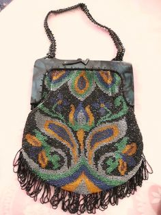 Art deco 1920s purse with faux malachite handle.  Bead work is needlepoint.