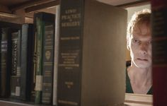 """S3 Ep15 """"Galvanize"""" - Barrow watches as Kira leaves the library."""