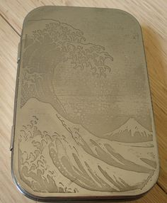 Etched altoid tins