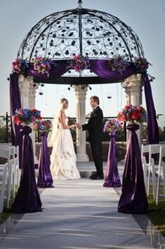 "Don't like the traditional ""colors of fall"", but still want a fall wedding? Why not try deep purples and blacks?"