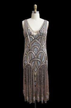 1920s Bead & Sequin Rose Gold Flapper   From a collection of rare vintage evening dresses at http://www.1stdibs.com/clothing/evening-dresses/
