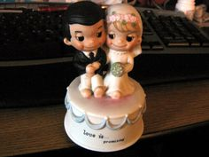 Vintage Schmid Spinning music box of an adorable wedding couple on a cake.  The couple spin around as it plays the Wedding March.   It measures 5  tal