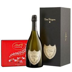 Dom's distinctive dark green shield, probably the best and definitely the most famous Champagne in the world, inspires respect and reverence.  Luxury's very essence. If Champagne has ever been a must taste, it's 750ml from Dom Pérignon.  The gift includes 750ml Dom Perignon champagne & 187 g Lindor Bonbons Box.  #domperignon #lindorbonsbons #gifts #giftideas Green Shield, Dom Perignon, Lindor, Corporate Gifts, Respect, Christmas Gifts, Dark, Bottle