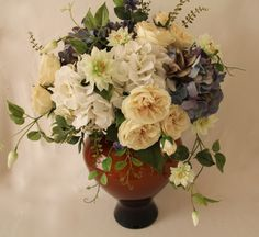 Artificial silk  flowers arrangement Blue and white hydrangea ,garden roses,clematis ,japanese boxwood.Design by Simone Vartan.
