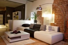 We love how brick adds warmth and character to an otherwise plain space. Check out our gallery, 38 Beautiful Living Rooms with Exposed Brick Walls, at http://www.homestratosphere.com/living-rooms-brick-walls/