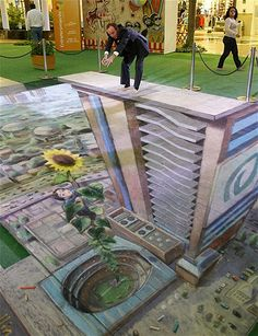 Image: A man looks at the 3D art piece drawn by British artist Julian Beever in a mall at Medellin, Colombia, Sept. 5, 2013. Beever draws wi...