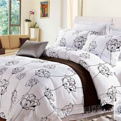Palais Cotton 4-Piece Duvet Cover Set Its light and airy floral pattern in white and black will add style and comfort to your bedroom. Designed with you in mind, it was engineered with 12 hard clips all around the duvet cover in order for you to place the duvet filling in without any difficulty and to keep it in place during night time. A quality piece that will keep your space feeling bright and relaxing.