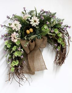 Primitive Country Hanging, Front Door Swag, Beautiful Wildflowers, Burlap Bow, Nest with Eggs, Great for Country Decor -- FREE SHIPPING. $125.00, via Etsy.