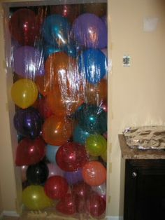 For a Birthday. Close Bedroom door. Put up wrapping paper, plastic, whatever with Balloons in between. When they wake up and open the door they are showered with balloons! Great for Kids!
