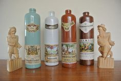 Vintage Stoneware Wine Bottles From Germany in Blue, White, Light Brown, and Dark Brown