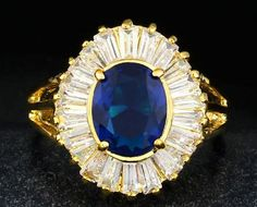 Luxurious blue AAA zircon ring with 14k yellow gold. Starting at $1