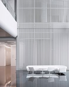 Large industrial enterprises aren't typically known for conducting business in jaw-dropping office interiors. The Midwest Inland Port Financial Town project in China's Xi'an International Trade & Logistics Park certainly defies that assumpt...