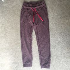 Lululemon Base Runner Pant III Jogger like Lululemon pant, worn once but a little too small for the way I wanted them to fit.  Relaxed sensation, pink/red color. There is a great pocket on the side for holding phone/music etc. lululemon athletica Pants Track Pants & Joggers