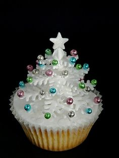Weddbook is a content discovery engine mostly specialized on wedding concept. You can collect images, videos or articles you discovered  organize them, add your own ideas to your collections and share with other people - Sparkly White Snowflake Christmas Tree Cupcake