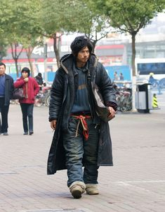 """'Brother Sharp' was a homeless man in China who inspired a designer to create a line of clothing in a style dubbed 'peasent chic'. A homeless fashion icon... Strange times:    """"On January 1st, 2011, fashion entrepreneur Zhuang Weiguo announced the launch of China's very first """"peasant chic"""" fashion brand, a luxury men's clothing line entirely inspired by the vagabond style of Brother Sharp."""""""