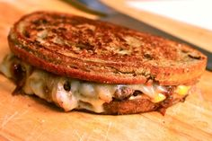 ULTIMATE PATTY MELT 6 tablespoons butter 2 slices rye bread 4 slices American cheese, torn into large pieces 4 slices Swiss cheese, torn into large pieces Kosher salt Freshly ground black pepper 1/2 pound freshly ground chuck, formed into two 4-ounce patties, roughly the size and shape of 1 slice bread 1 large onion, split in half, sliced thin from pole to pole (about 2 cups) 1/2 cup water
