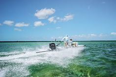Heading out from the Bahamas' Abaco Lodge for a day of fly fishing on the flats with the legend Lefty Kreh. Photo by Andy Anderson. | Garden & Gun