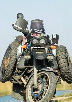 Motorcycle Touring Your doing it right! It's not the chrome, it's not the tag, it's about a making a direct connection to the world around you through the two , sometimes three ;) , wheels beneath you.