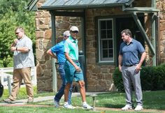 US President Barack Obama (C) arrives at the Caves Valley golf club in Owings…