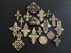 Africa | Set of silver coptic crosses bought in Egypt some 25 years ago. The silver brooch was also bought at that time and represents typical Nubian houses in Upper Egypt. | © Jose M Pery.  There are Coptic people in both Egypt and Ethiopia.