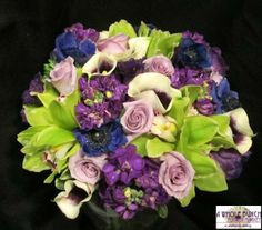 Callas, cymbidium orchids, roses, stock, and other seasonal flowers make up this gorgeous bouquet.