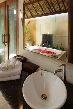 Indoor/outdoor Balinese bathroom
