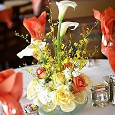 Wedding Reception Flowers    Google Image Result for http://photos.weddingbycolor-nocookie.com/p000006880-m26892-p-photo-79141/Coral--Yellow--and-Cream-Centerpieces.jpg