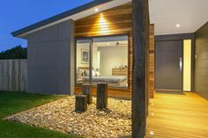 diff textures - uses three main cladding types to give it that wow factor. James Hardie Scyon Matrix, natural timber cladding as well as rendered foam. Three reclaimed timber posts welcome guests to this house in majestic style. Interior Cladding, House Cladding, Timber Cladding, Wall Cladding, Facade House, External Cladding, Facade Design, Exterior Design, House Design